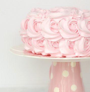 Pink birthday cake on stand