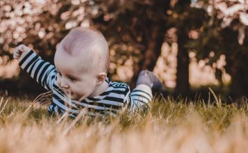 Baby in grass camping