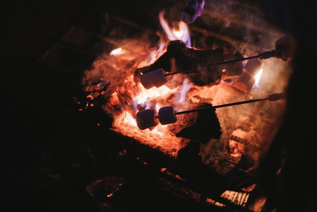 s'mores cooking over a campfire