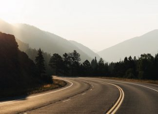 Winding road through mountains with sunlight