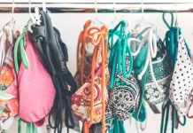 row of bikinis on rack
