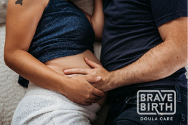 Image of a pregnant woman and her partner embracing for Brave Birth Doula Care in the Portland Mom & Baby Guide