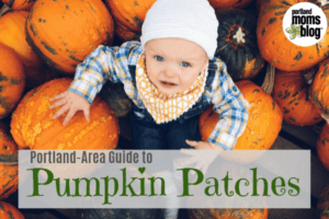 Image of a baby looking up from a pile of pumpkins with the words Portland-Area Guide to Pumpkin Patches with the Portland Moms Blog Logo