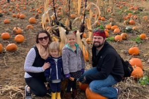 hillary at pumpking patch with family