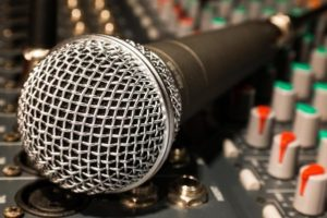 Close up image of a microphone on a mixer