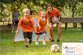Image of children happily running and playing with a logo for Soccer Shots Summer Camp