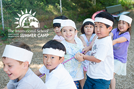 Children playing tug-of-war at the International School's Summer Camp
