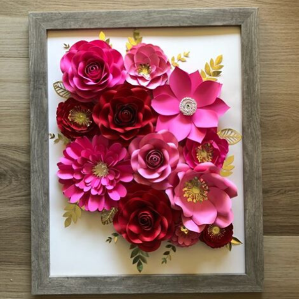 Mother's Day gift of framed paper flower arrangement featuring flowers in bright pink and deep reds with gold leaves made by The Paper Flower Studio