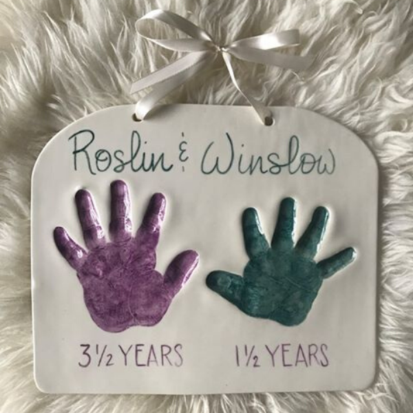 2 Ceramic hand prints from siblings Roslin (3 1/2 years) and Winslow (1 1/2 years) for Mother's Day gift