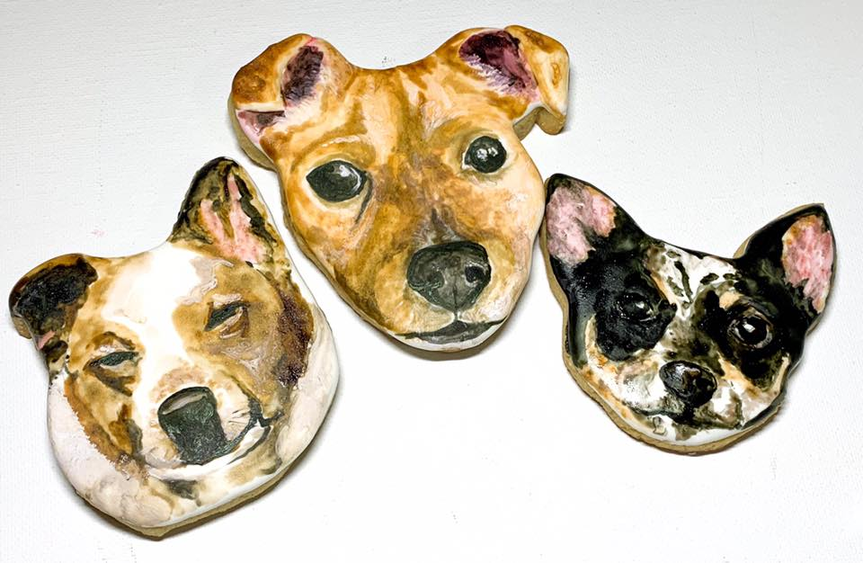 Cookies with realistic images of dogs painted on them