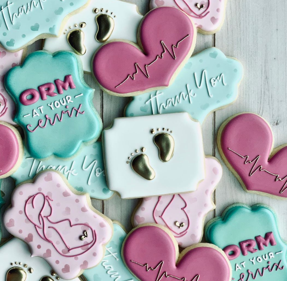"""Blue pink and white cookies decorated for baby doctor including """"at your cervix"""""""