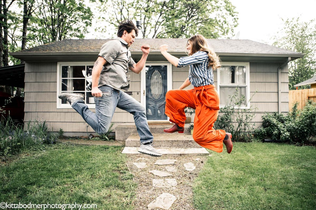 A married couple caught in mid jump by Kitta Bodmer Photography