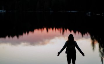 Woman in Nature at Lake - The Art of Surrender