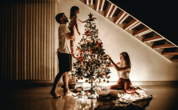 decorating the tree for christmas photos