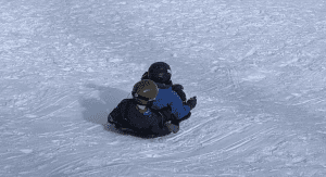 Sledding down the mountain
