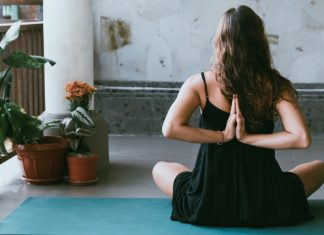 Person in yoga pose on patio
