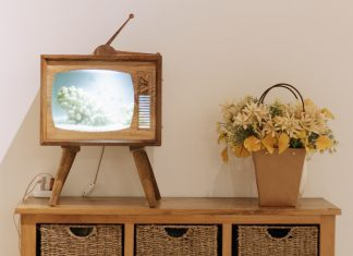 vintage tv on stand with yellow flowers