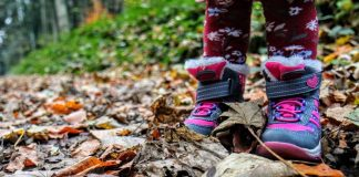 Kid shoes in leaves