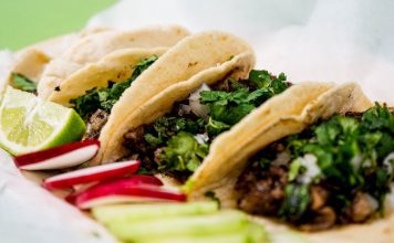 Image of tacos in a row