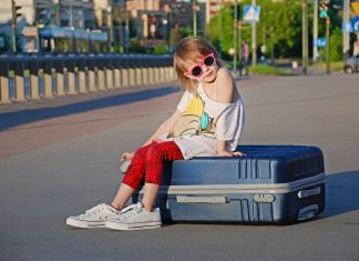 child packed for vacation
