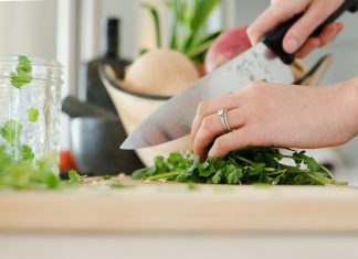 woman chopping herbs
