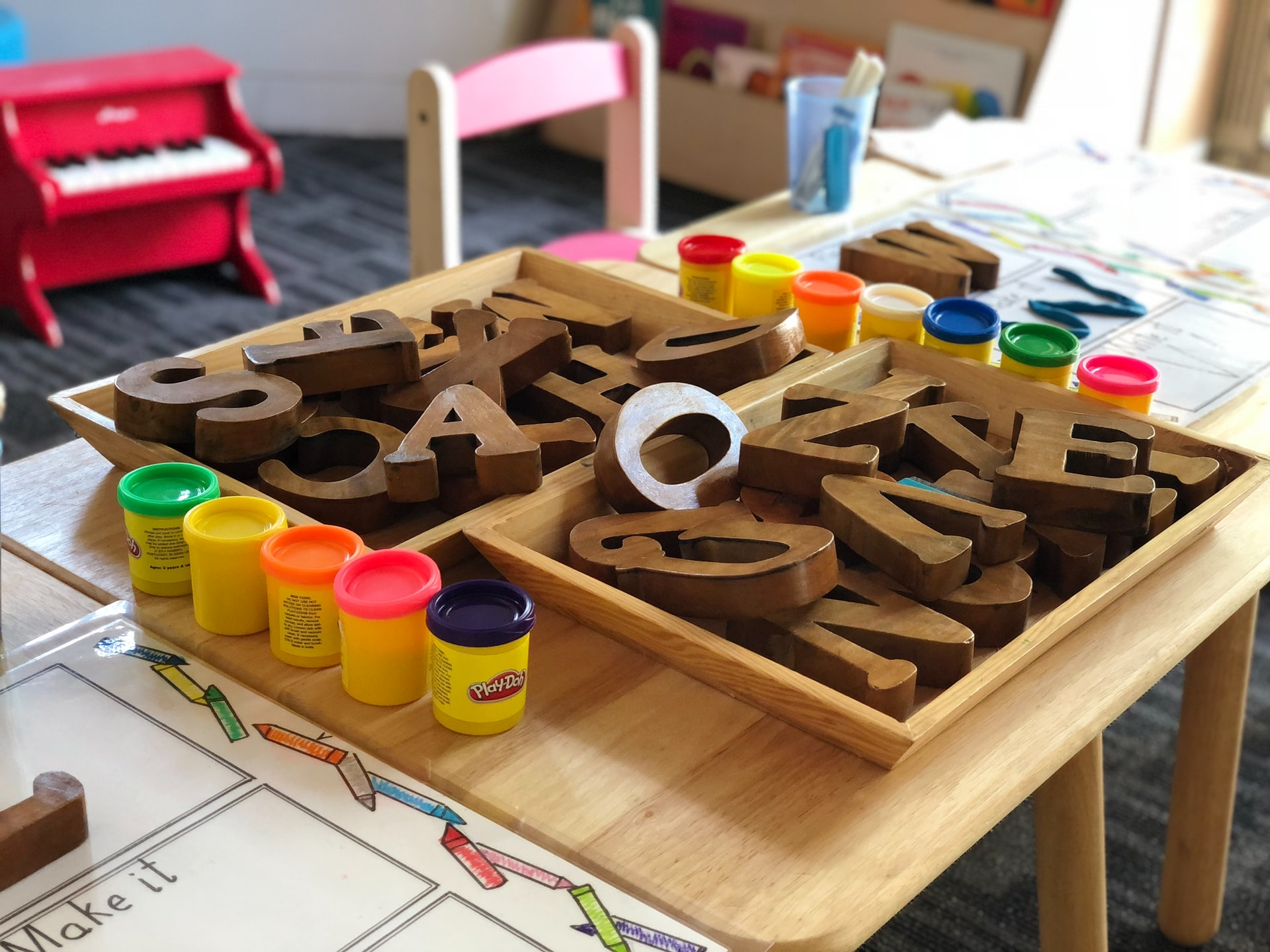 Wooden puzzle pieces and play-doh