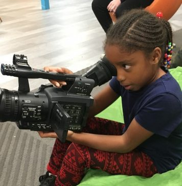 Future Filmmakers: Kid with camera filming